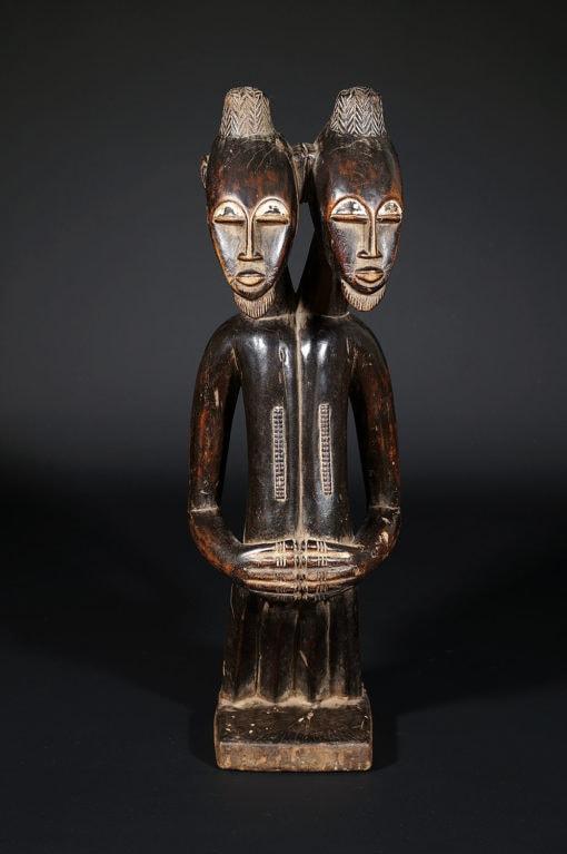 Statue bicéphale de siamois de Côte d'ivoire